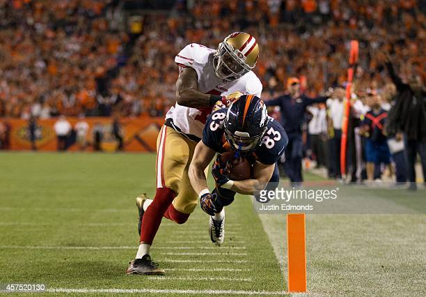 Wide receiver Wes Welker of the Denver Broncos is forced out of bounds at the goal line by strong safety Antoine Bethea of the San Francisco 49ers on...