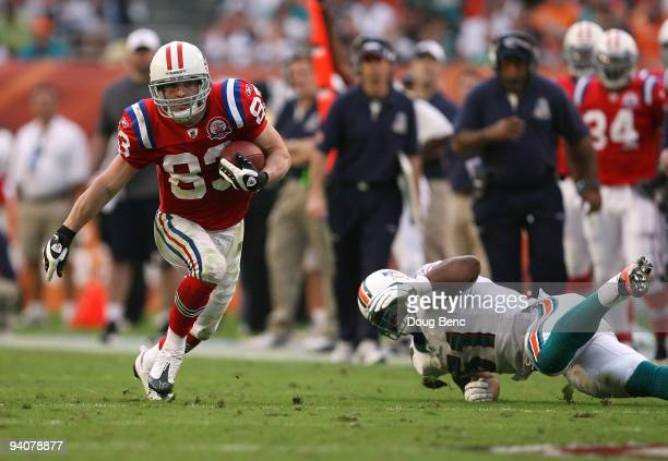 Wide receiver Wes Welker of the New England Patriots gets past linebacker Akin Ayodele of the Miami Dolphins at Land Shark Stadium on December 6 2009...
