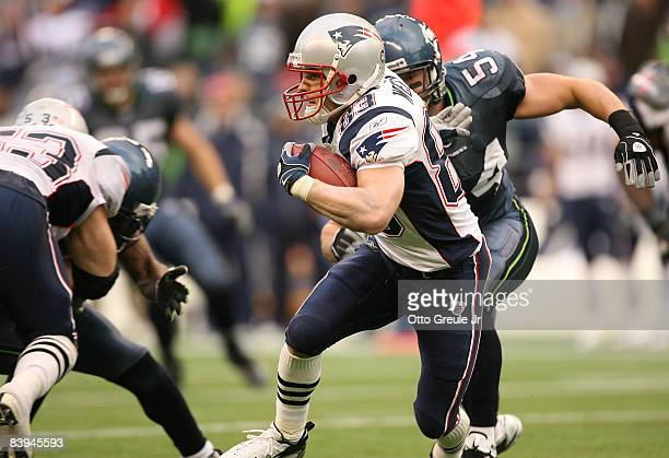 Wide receiver Wes Welker of the New England Patriots rushes against Will Herring of the Seattle Seahawks on December 7 2008 at Qwest Field in Seattle...