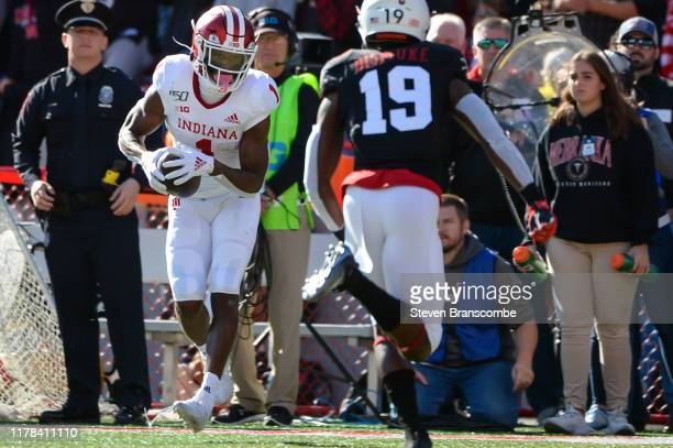 Wide receiver Whop Philyor of the Indiana Hoosiers catches a pass against safety Marquel Dismuke of the Nebraska Cornhuskers at Memorial Stadium on...
