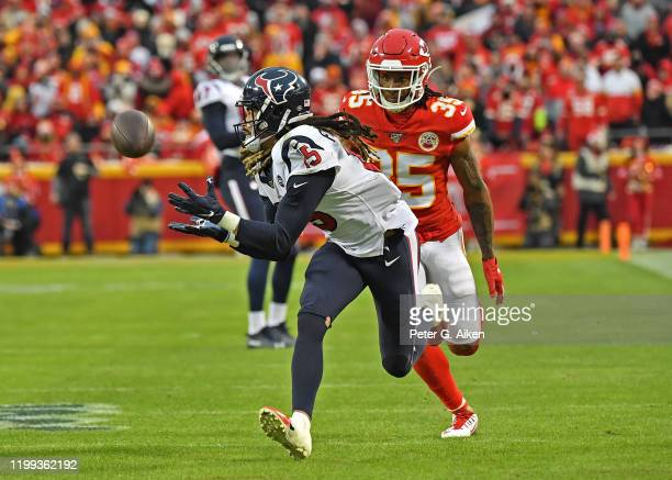 Wide receiver Will Fuller of the Houston Texans catches a pass down field against cornerback Charvarius Ward of the Kansas City Chiefs in the second...