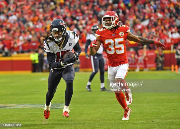 Wide receiver Will Fuller of the Houston Texans runs down field against cornerback Charvarius Ward of the Kansas City Chiefs in the second half...