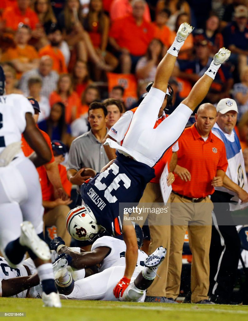 Wide receiver Will Hastings #33 of the Auburn Tigers flips over end after being tackled by linebacker Tomarcio Reese #33 of the Georgia Southern Eagles during the second half of an NCAA college football game at Jordan Hare Stadium on Saturday, September 2, 2017 in Auburn, Alabama.