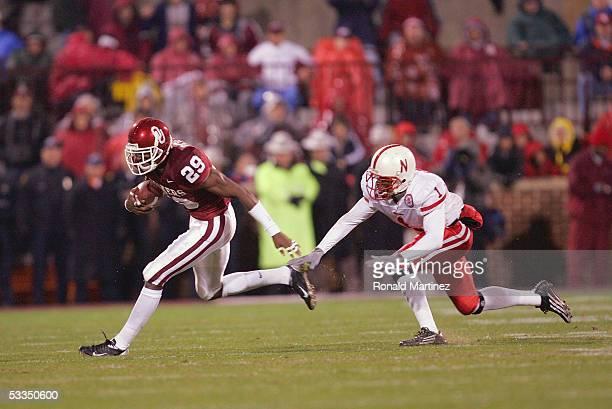 Wide receiver Will Peoples of the University of Oklahoma Sooners runs upfield against cornerback Lornell McPherson of the University of Nebraska...