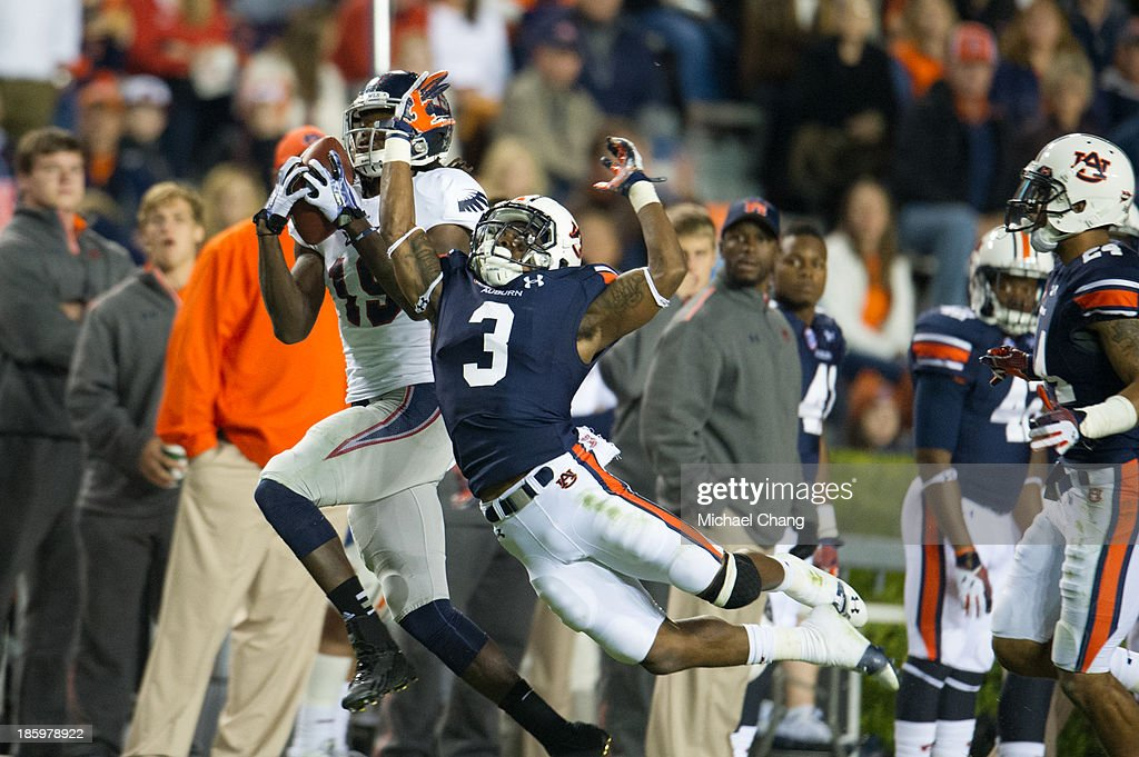 Wide receiver William Dukes #19 of the Florida Atlantic Owls catches a pass over defensive back Jonathan Jones #3 of the Auburn Tigers on October 26, 2013 at Jordan-Hare Stadium in Auburn, Alabama. Auburn defeated Florida Atlantic 45-10.