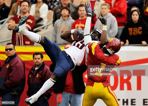 Wide receiver William Wright of the Arizona Wildcats catches a pass for a 19yard gain against corner back TJ Bryant of the USC Trojans on the Trojans...