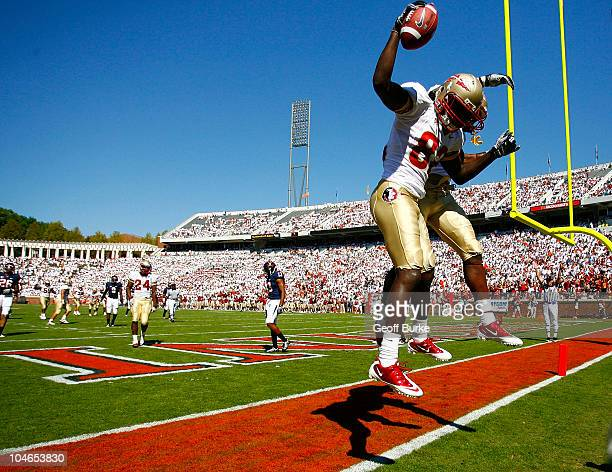 Wide receiver Willie Haulstead and tight end Beau Reliford of the Florida State Seminoles celebrate after Haulstead's touchdown against the Virginia...