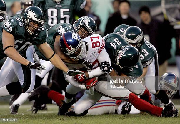 Wide receiver Willie Porter of the New York Giants is tackled on a kick-off return during the game against the Philadelphia Eagles on December 11,...
