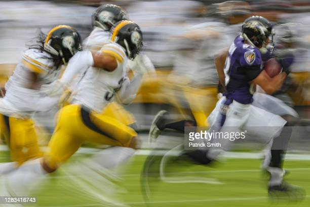 Wide receiver Willie Snead of the Baltimore Ravens carries the ball against the Pittsburgh Steelers during the first half at M&T Bank Stadium on...