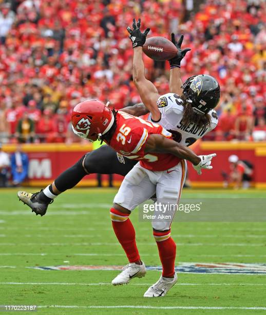 Wide receiver Willie Snead of the Baltimore Ravens catches a pass against cornerback Charvarius Ward of the Kansas City Chiefs during the second half...