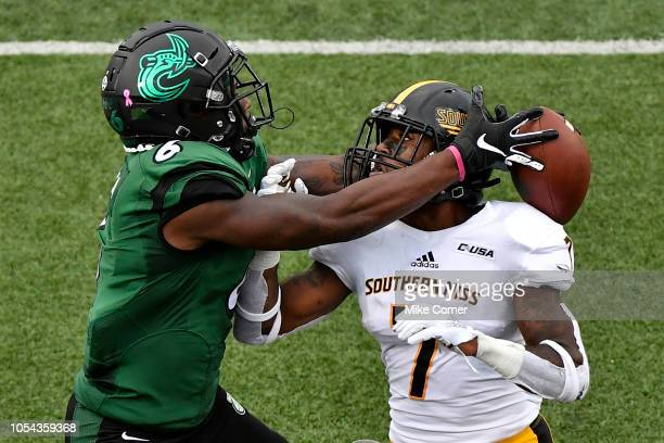 Wide receiver Workpeh Kofa of the Charlotte 49ers jumps up for a pass in the end zone and traps the football behind the head of defensive back Ty...