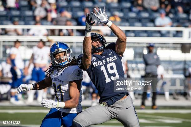 Wide receiver Wyatt Demps of the Nevada Wolf Pack eyes the ball as cornerback Andre Chachere of the San Jose State Spartans watches for the catch at...