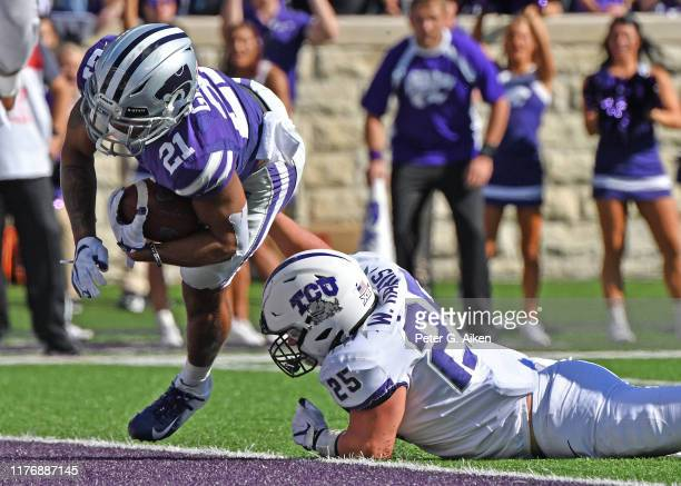 Wide receiver Wykeen Gill of the Kansas State Wildcats rushes in for a touchdown against defensive end Wyatt Harris of the TCU Horned Frogs during...