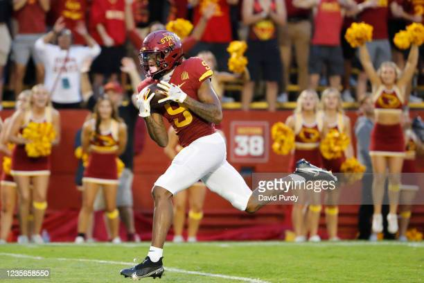 Wide receiver Xavier Hutchinson of the Iowa State Cyclones pulls in a pass for a touchdown in the end zone in the first half of play against the...