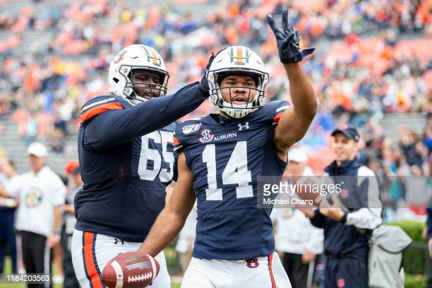 Wide receiver Zach Farrar of the Auburn Tigers celebrates with offensive lineman Alec Jackson of the Auburn Tigers after scoring a touchdown during...