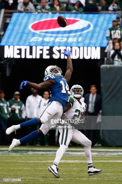 Wide receiver Zach Pascal of the Indianapolis Colts goes up for a catch against cornerback Morris Claiborne of the New York Jets during the second...