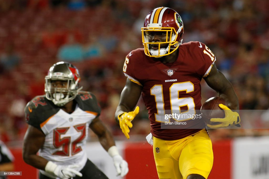 Wide receiver Zach Pascal #16 of the Washington Redskins evades linebacker Cameron Lynch #52 of the Tampa Bay Buccaneers during a carry in the third quarter of an NFL preseason football game on August 31, 2017 at Raymond James Stadium in Tampa, Florida.