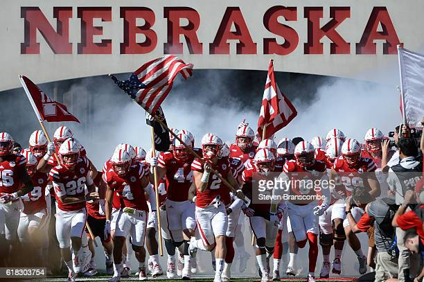 Wide receiver Zack Darlington of the Nebraska Cornhuskers leads the team on the field against the Purdue Boilermakers at Memorial Stadium on October...