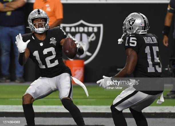 Wide receiver Zay Jones and wide receiver Nelson Agholor of the Las Vegas Raiders celebrate after Jones caught a touchdown pass against the New...