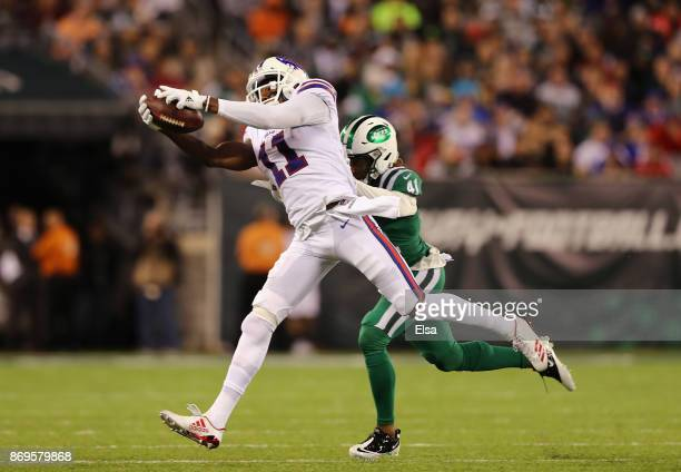 Wide receiver Zay Jones of the Buffalo Bills makes a catch against cornerback Buster Skrine of the New York Jets during the third quarter of the game...