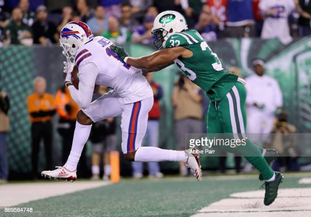 Wide receiver Zay Jones of the Buffalo Bills scores a touchdown against strong safety Jamal Adams of the New York Jets during the second quarter of...