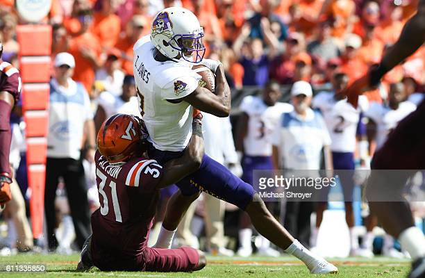 Wide receiver Zay Jones of the East Carolina Pirates is hit after his reception by cornerback Brandon Facyson of the Virginia Tech Hokies in the...