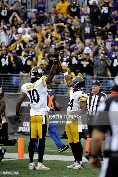 Wide receivers Antonio Brown and Martavis Bryant of the Pittsburgh Steelers celebrate a touchdown by Brown during a game against the Baltimore Ravens...