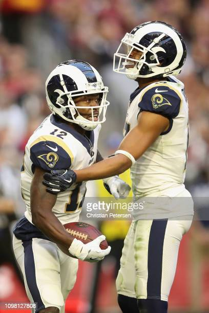 Wide receivers Brandin Cooks and Robert Woods of the Los Angeles Rams celebrate during the NFL game against the Arizona Cardinals at State Farm...