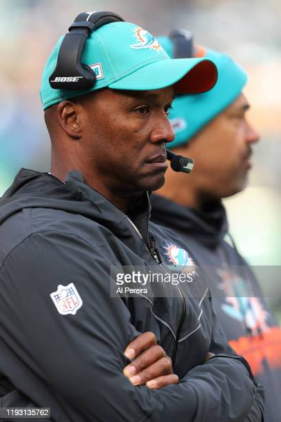 Wide Receivers Coach Karl Dorrell of the Miami Dolphins follows the play against the New York Jets in the first half at MetLife Stadium on December 8...