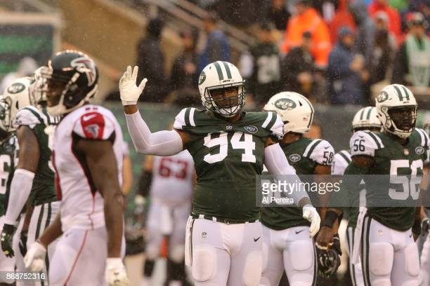 Wide Receivers Coach Karl Dorrell of the New York Jets in action against the Atlanta Falcons in a heavy rain storm during their game at MetLife...