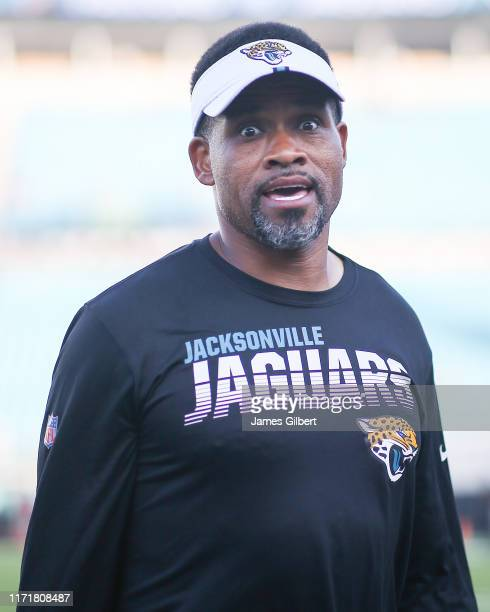 Wide Receivers Coach Keenan McCardell of the Jacksonville Jaguars looks on before the start of a preseason game against the Atlanta Falcons at TIAA...