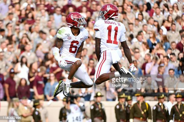 Wide receivers DeVonta Smith and Henry Ruggs III of the Alabama Crimson Tide celebrate celebrate scoring a touchdown in the second quarter during the...