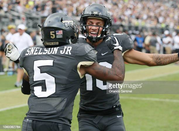 UCF wide receivers Dredrick Snelson and Tre Nixon celebrate after a Snelson touchdown against Navy at Spectrum Stadium in Orlando Fla on Saturday Nov...