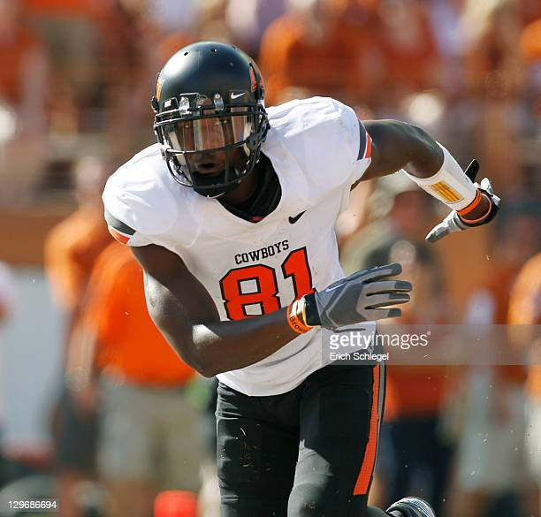 Wide receivers Justin Blackmon of the Oklahoma State University Cowboys celebrates a second quarter touchdown against the University of Texas...