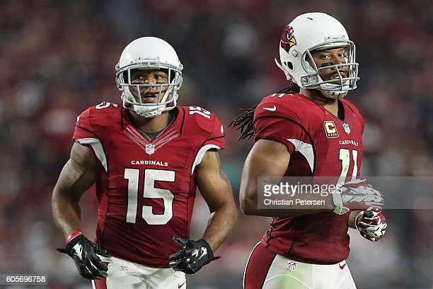 Wide receivers Larry Fitzgerald and Michael Floyd of the Arizona Cardinals during the NFL game against the New England Patriots at the University of...
