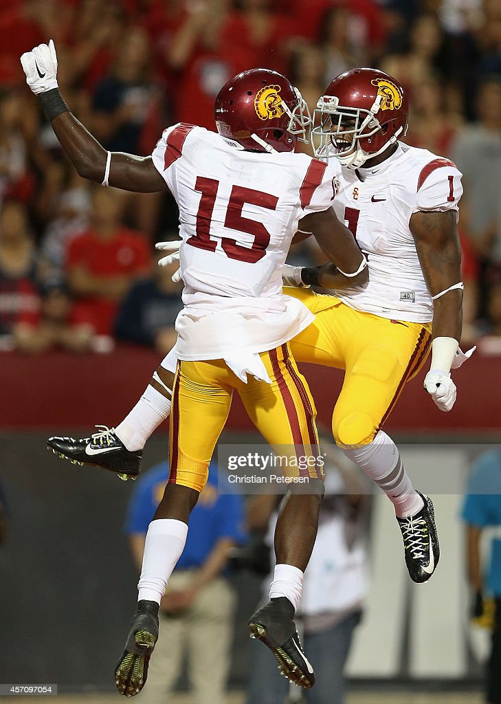 Wide receivers Nelson Agholor #15 and Darreus Rogers #1 of the USC Trojans celebrate after Agholor scored a 21 yard touchdown reception against the Arizona Wildcats during the third quarter of the college football game at Arizona Stadium on October 11, 2014 in Tucson, Arizona. The Trojans defeatred the Wildcats 28-26.