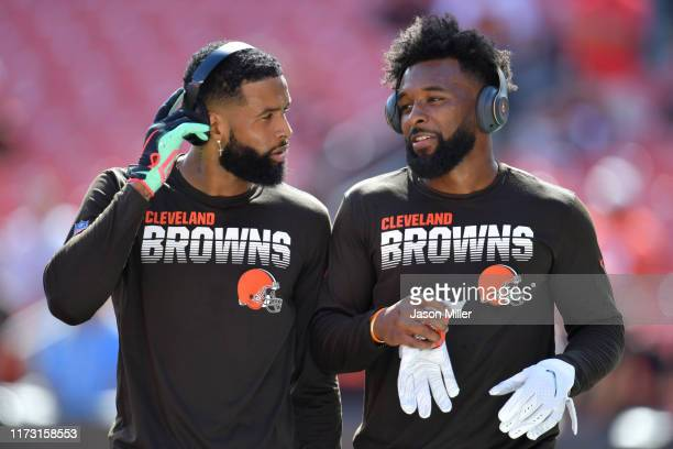 Wide receivers Odell Beckham and Jarvis Landry of the Cleveland Browns walk together during warm ups before playing against the Tennessee Titans in...