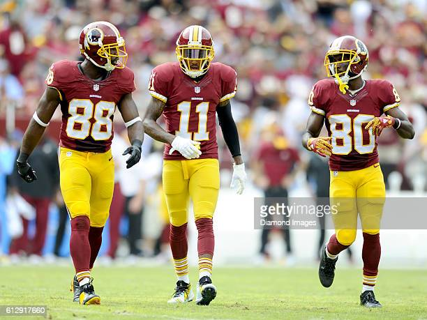 Wide receivers Pierre Garcon DeSean Jackson and Jamison Crowder of the Washington Redskins walk onto the field during a game against the Cleveland...
