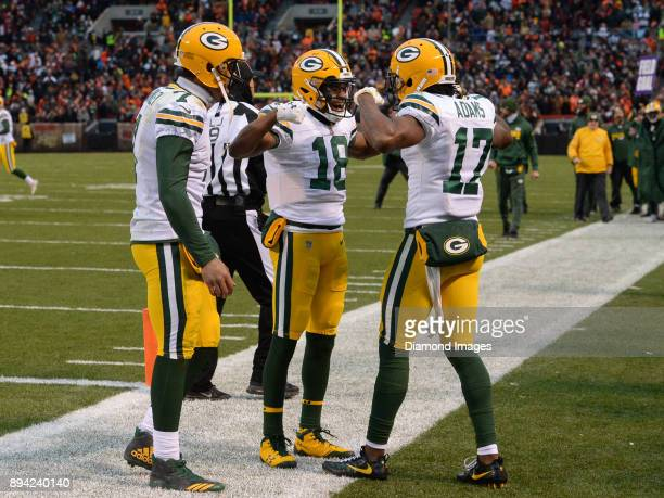 Wide receivers Randall Cobb Devante Adams and quarterback Brett Hundley of the Green Bay Packers celebrate after a game tying touchdown catch by...