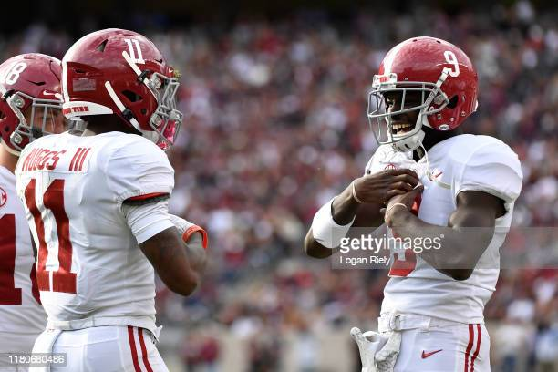 Wide receivers Xavier Williams and Henry Ruggs III of the Alabama Crimson Tide celebrate after a touchdown during the game against Texas AM Aggies at...