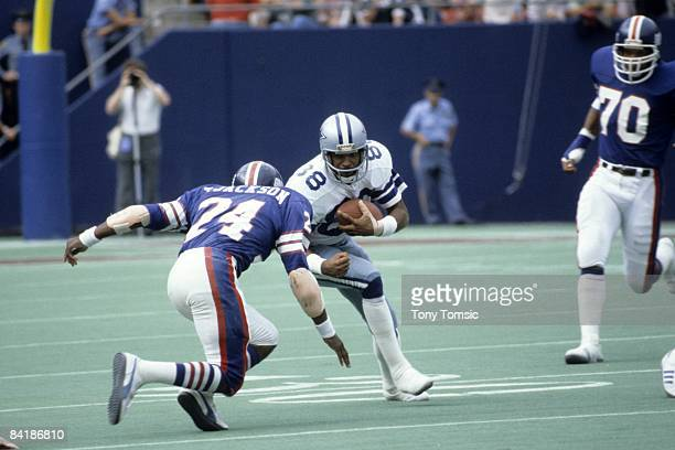 Wide receover Drew Pearson of the Dallas Cowboys tries to avoid the tackle of defensive back Terry Jackson of the New York Giants during a game on...