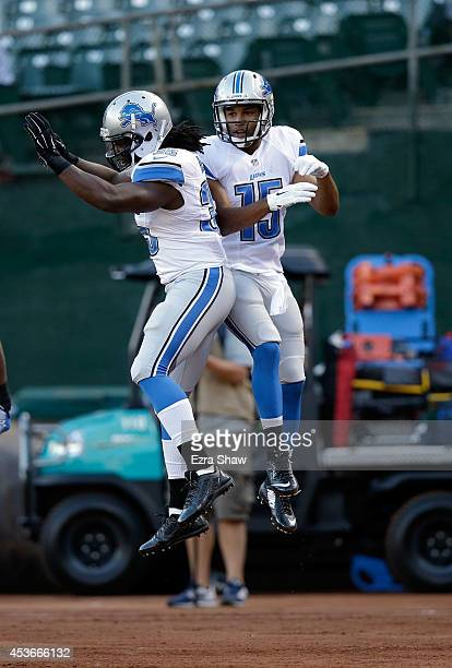 Wide recever Golden Tate and running back Joique Bell of the Detroit Lions celebrate against the Oakland Raiders during their preseason game at Oco...