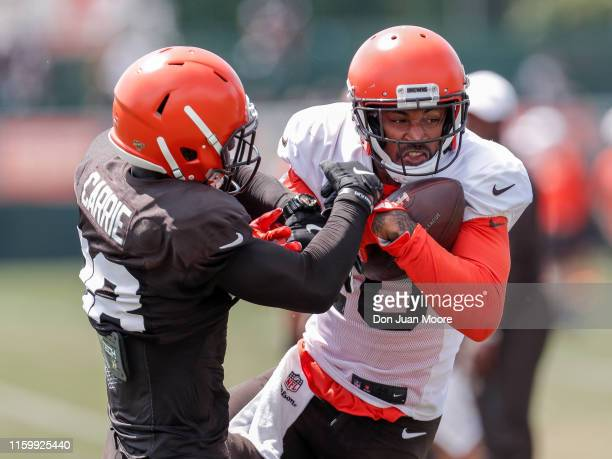 Wide Reciever Jaelen Strong makes a catch over Cornerback TJ Carrie during the Cleveland Browns Training Camp on August 5 2019 at the Cleveland...