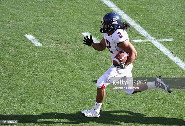 Wide reciver Keola Antolin of the Arizona Wildcats rushes for a 68 yard touchdown against the Arizona State Sun Devils during the college football...
