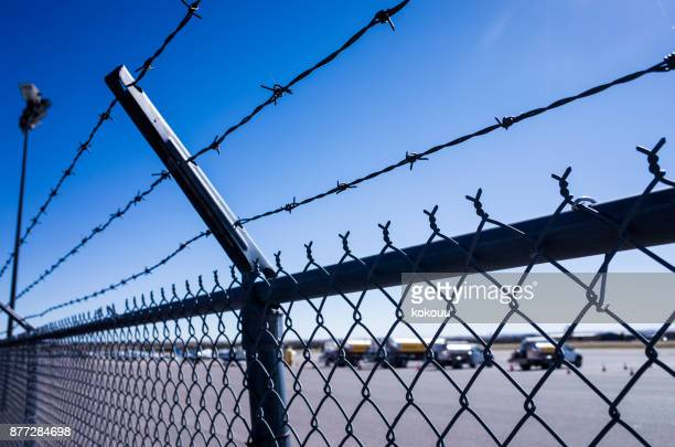 wide runway and small aircraft. - security check stock photos and pictures