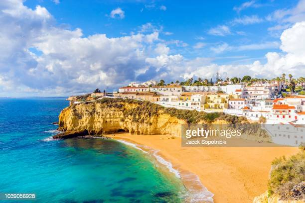 wide sandy beach and white architecture of charming carvoeiro, algarve, portugal - algarve fotografías e imágenes de stock