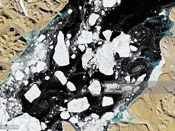 Wide satellite image of Hans Island an uninhabited rock in the Arctic and a territorial dispute between Canada and Denmark