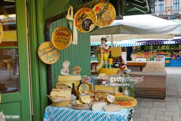 wide selection of chees at the viktualienmarkt. munich, bavaria. - viktualienmarkt stock pictures, royalty-free photos & images