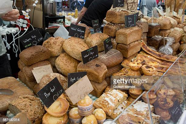 A wide selection of high quality and organic bread and pastries on sale at a stall in Broadway Market in the London Fields district of Hackney This...