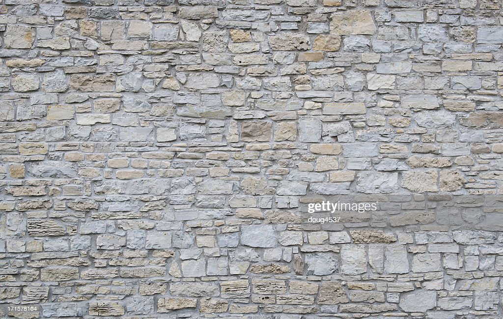 Wide shot of a plain limestone wall : Stock Photo